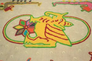One of the unique traditional trinkets that can be found in the implementation of Erau is the use of coral ponds. A coral pond is a painting or colorful image that serves as the base for the implementation of certain sacred rituals in Erau. This picture or painting is made of rice which is given various colors. The rice is arranged in such a way as to form special motifs, each of which has a specific meaning and function.